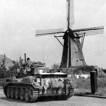 Guards Cromwell moves past a windmill