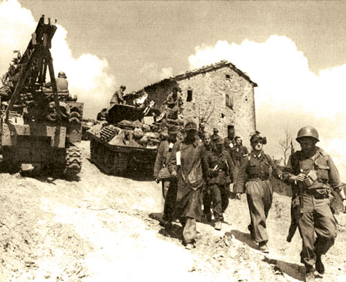 10th Mountain Division troops escort German prisoners of war
