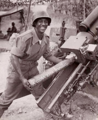 A Brazilian soldier prepares to load a 105mm howitzer