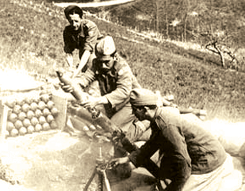 The men of the BEF prepare to fire a mortar round