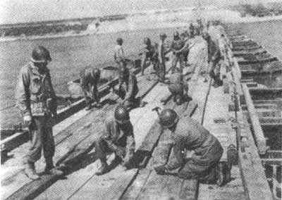 Brazilian engineers constructing a pontoon bridge