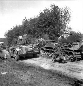 Manitoba Dragoons Staghound passes an abandoned Tiger II