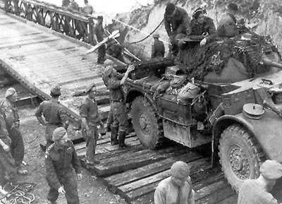 Staghound crosses a temporary bridge