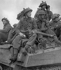 Riflemen riding a tank