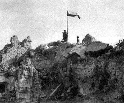 "12th ""Podolski"" Lancers hoist the Polish flag over the ruins of the monastery."