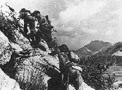 Poles clamber over the rugged hill around Cassino.
