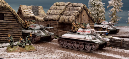 Soviet T-34 tanks advance with tank riders