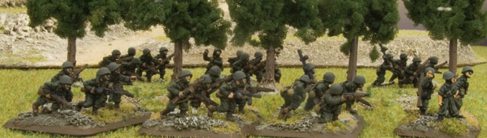 Italian infantry move through a forrest