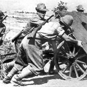 Alpini pushing mountain gun
