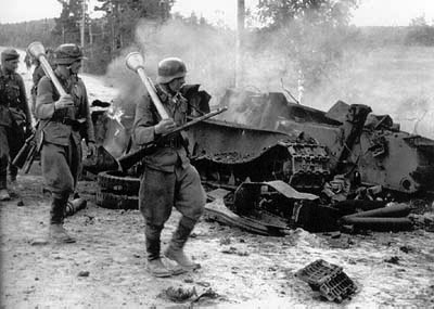 Finnish Troop March Past a wreaked T-34