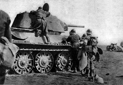 Romanian Infantry check out a T-34