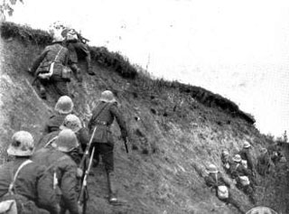 Romanian infantry climb a river bank