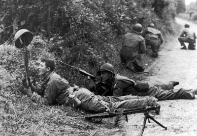 US Riflemen check the other side of the Bocage