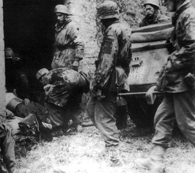 Men of the Waffen-SS and Fallschirmjäger look after the wounded