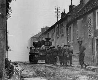 Canadians move through Falaise