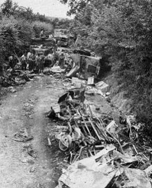 Destroyed German vehicles block a road