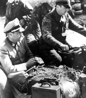 "Kurt ""Panzer"" Meyer on his motorcycle with passenger Fritz Witt"