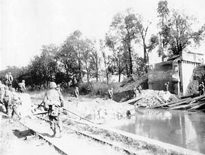 US Infantry advance along a canal