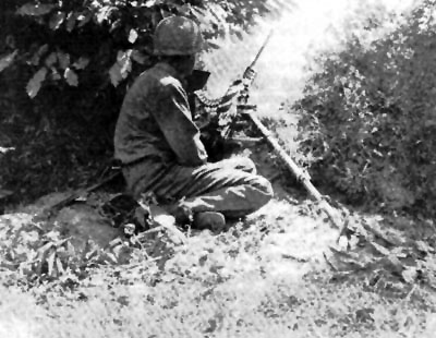 A .50cal machine-gun sets up in the bocage