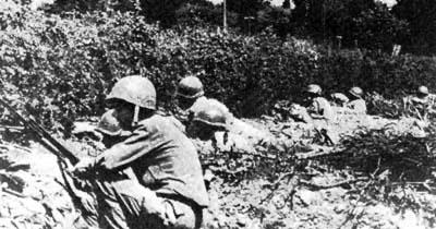US infantry take cover in the bocage