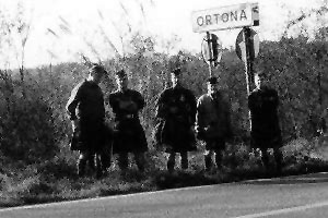 Canadian Highlanders pose by a Ortona road sign.