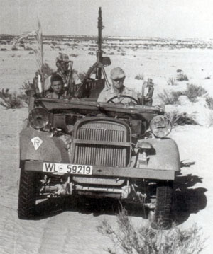 Fallschirmjäger with one of the few transport vehicles they had in the desert.