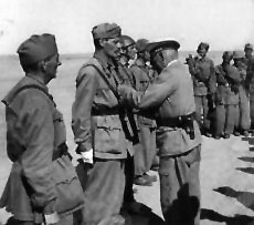 Ramcke giving medels to Italian troops