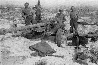 Men of the 24th Battalion with one of the captured 7.5cm PaK40s at Tebaga Gap