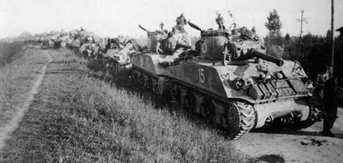 New Zealand Shermans halt during a march