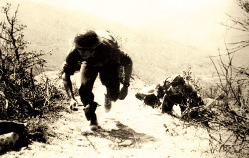 South Africans climb a a hill on attack