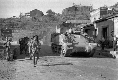 British armour advances down an Italian road