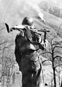 Italian RSI soldier with his German supplied MG-42.