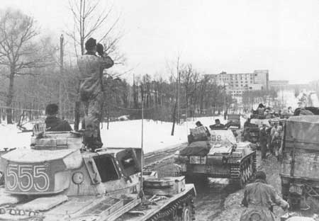 Panzer IIIs moving a road