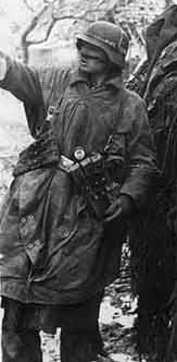 Luftwaffe Field Trooper in his rain puncho