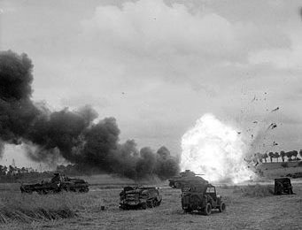 A German Mortar round hits a division vehicle