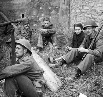 Canadian soldiers watch a French woman and German prisoners