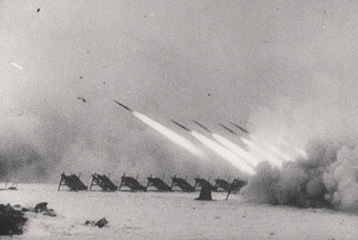 Heavy 300mm rockets launched from M-30 frames soften up the Fascists before the assault begins!