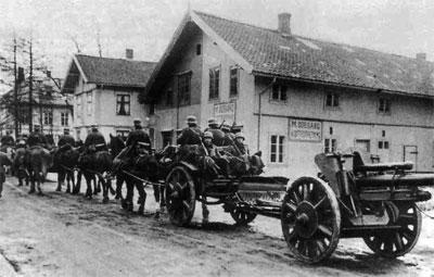 A leFH18 10.5cm Howitzer being pulled by a horse limber