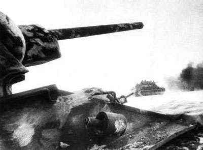 Soviet T-34 tanks and riflemen on the move