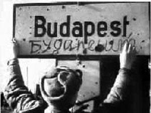 Soviet infantryman translates Budapest sign