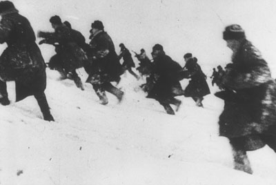 Soviet riflemen advance through the snow