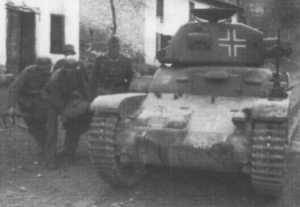 A Renault R-35 in German service with the command cupola removed and the two-piece hatch fitted directly on the turret