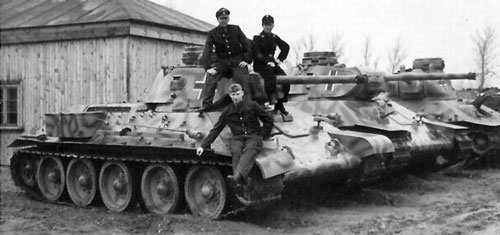 Beutepanzer T-34 mod 41/42's with a nice camouflage paint scheme.