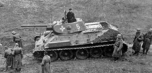 T-34 mod 1941/42 using a flag that's tied down on the rear panel of tank.