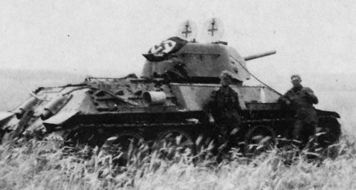 T-34 mod 1942/43 using a flag that's tied down on the rear panel of the turret.