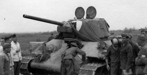 T-34 mod 1942/43 using a flag that's tied down over the front of the turret.
