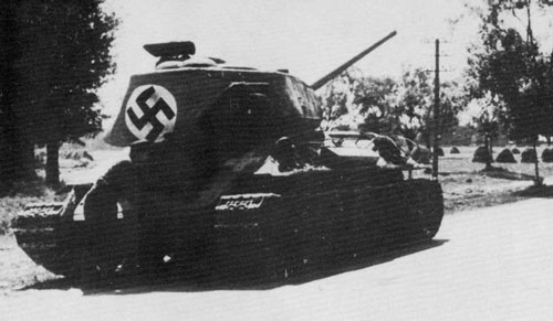 T-34/85 using a flag that's tied down on the rear panel of the turret.