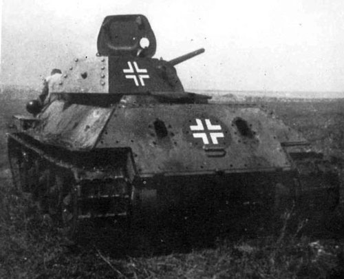 T-34 mod 1941/42 using a German Cross on the side (Rear section) of the turret, and on the rear panel of the tank