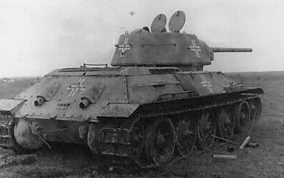 T-34 mod 1942/43 using a German Cross on the side (Front section) of the turret, on the rear panel of the turret, & on the rear panel of the tank and on the side (Mid section) of the tank.