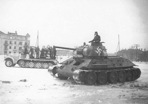 T-34 mod 1942/43 using a Swastika on the side (Front section) of the turret, on the side (Mid section) of the turret & under the barrel of the tank.